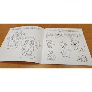 Kalėdinė staigmena. 3-4 metų vaikams. 4 knygelės (3 užduočių ir 1 lipdukų), 250 lipdukų, 6 spalvoti pieštukai, 3 kalėdiniai žaisliukai 11